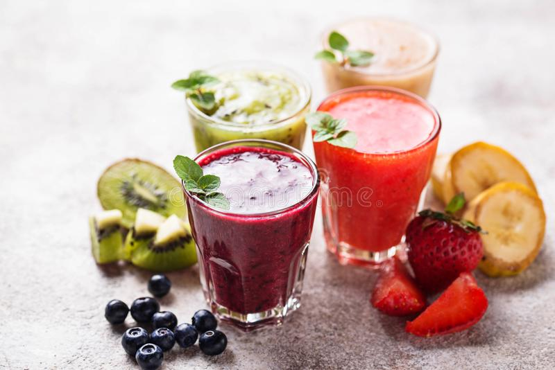 Assortment of various healthy smoothies. Selective focus stock photo