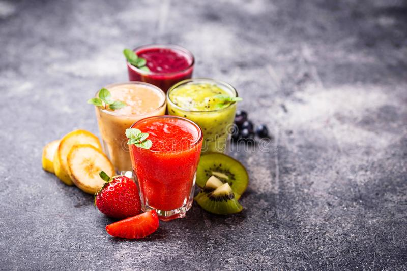 Assortment of various healthy smoothies. Selective focus stock image