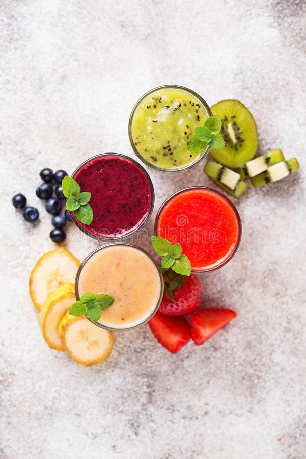Assortment of various healthy smoothies. Top view royalty free stock photo