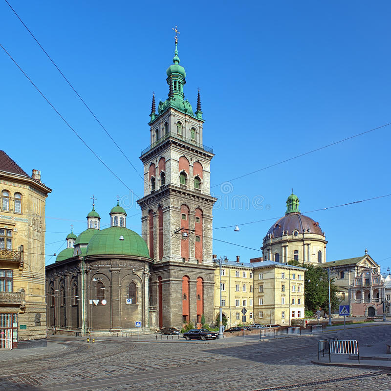 Assumption Church and Dominican Church in Lviv. Assumption Orthodox Church with Korniakt Tower and Dominican Catholic Church in Lviv, Ukraine royalty free stock photography