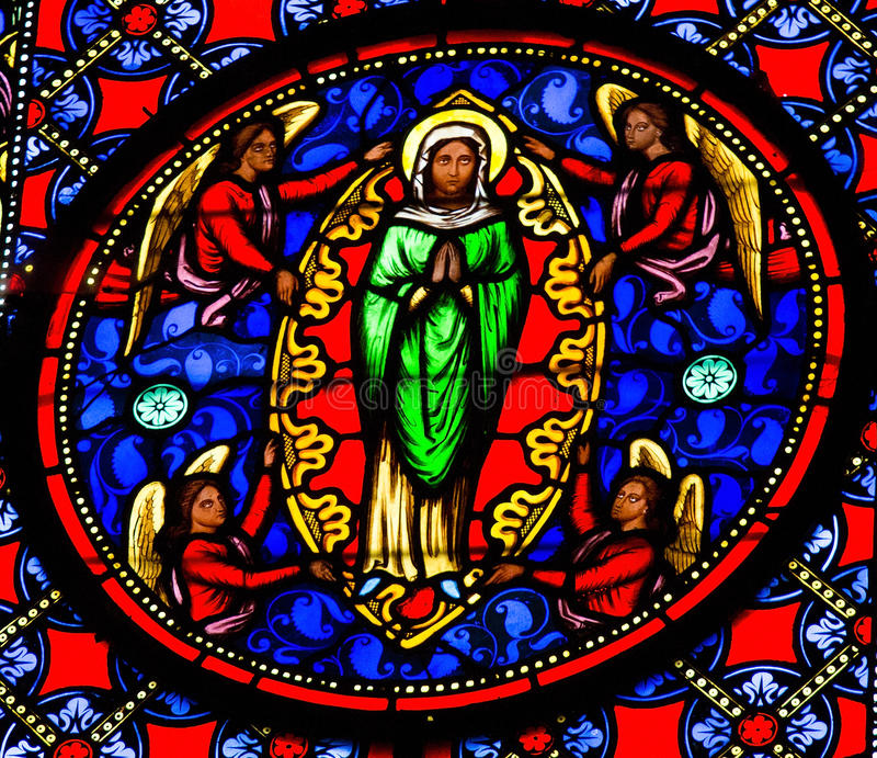 Assumption of Mary. Stained glass window depicting Assumption of Mary in Bayeux, Calvados, France stock photo