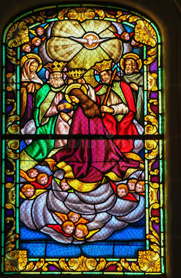 Assumption of Mary. Stained glass window depicting the Assumption of the Virgin Mary, in the church of Ronda, Spain stock image