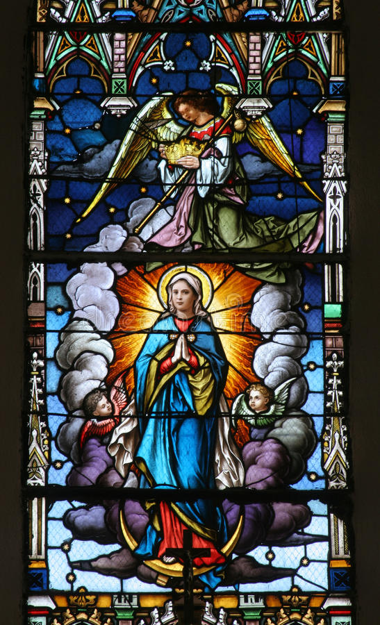 Assumption of the Virgin Mary. Stained glass church window stock photography