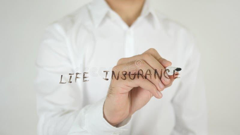 Assurance-vie, écrite sur le verre images stock