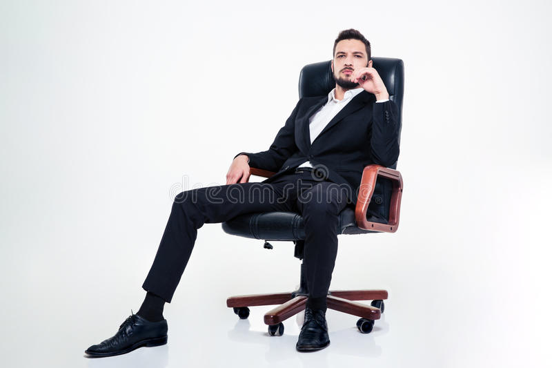 Assured confident business man with beard sitting in office chair royalty free stock images