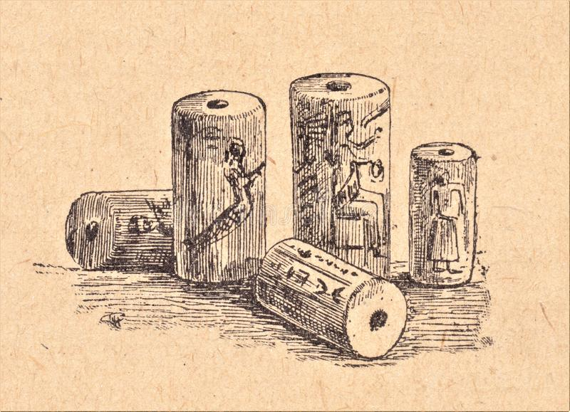 Assyrian cylinders. These cylinders were used as the stamps we are currently using to seal our letters with wax. The Assyrians used it to sign their contracts royalty free illustration