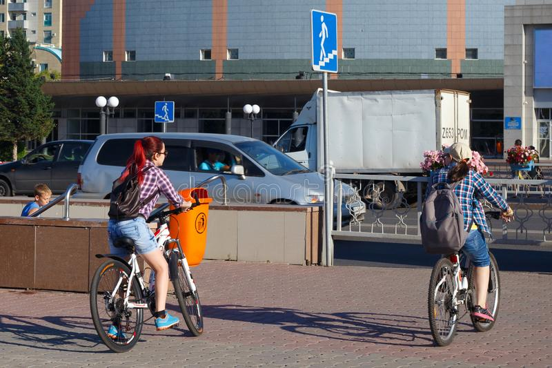 ASTANA, KAZAKHSTAN - JULY 25, 2017: Unknown young people with bikes near underground pedestrian crosswalk in the center of town. stock photos
