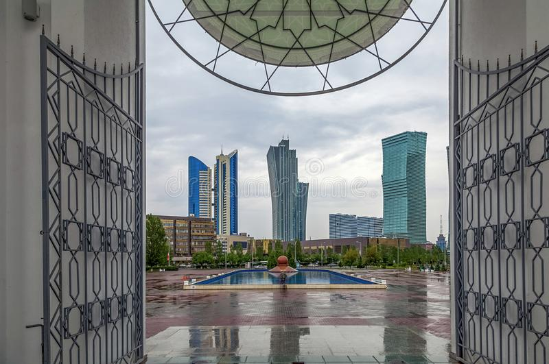 ASTANA, KAZAKHSTAN - JUNE 28, 2016: View of the skyscrapers from the entrance arch of the mosque Nur-Astana. stock images