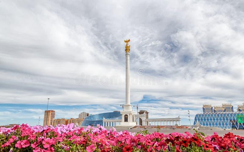 Astana, Kazakhstan - September 3, 2016: The area of Kazakhstan`s. Independence, Stella Kazak Eli on a background of clouds royalty free stock images
