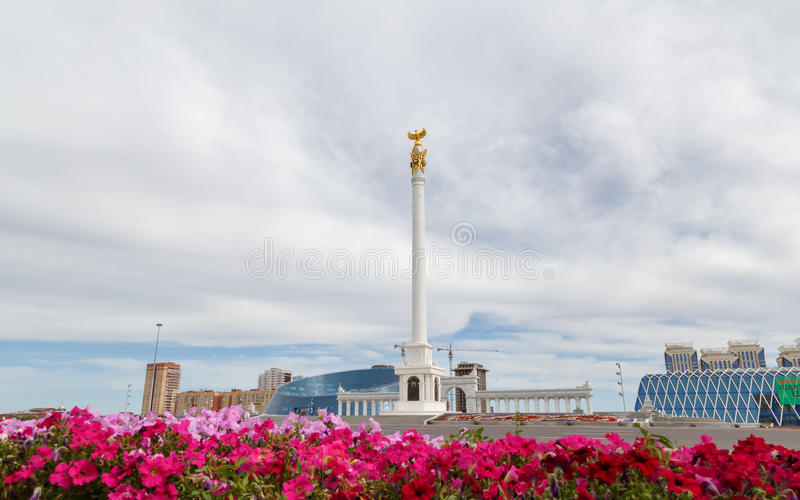 Astana, Kazakhstan - September 3, 2016: The area of Kazakhstan`s. Independence, Stella Kazak Eli on a background of clouds royalty free stock photos