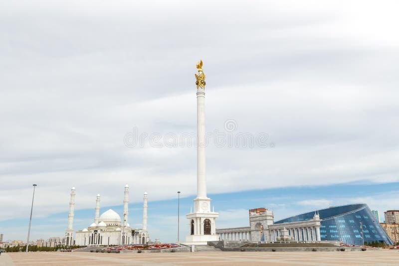 Astana, Kazakhstan - September 3, 2016: The area of Kazakhstan`s. Independence, Stella Kazak Eli on a background of clouds stock images