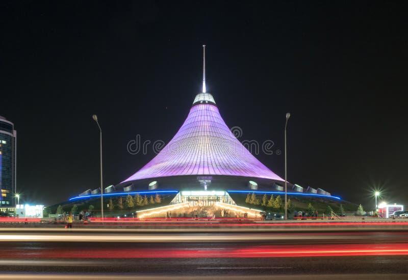 Astana, Kazakhstan - September 5, 2016: Khan Shatyr shopping center. Night traffic royalty free stock photography