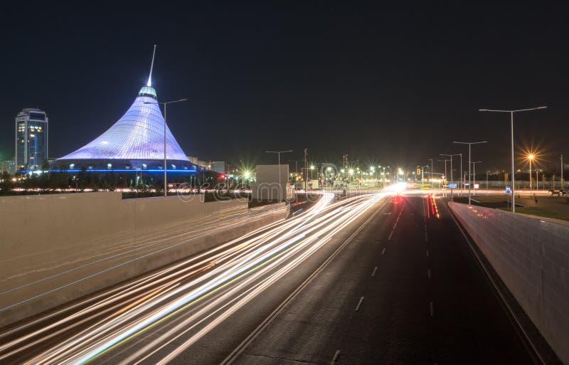 Astana, Kazakhstan - September 5, 2016: Prospect Kunaeva and Khan Shatyr shopping center. Night traffic stock photography