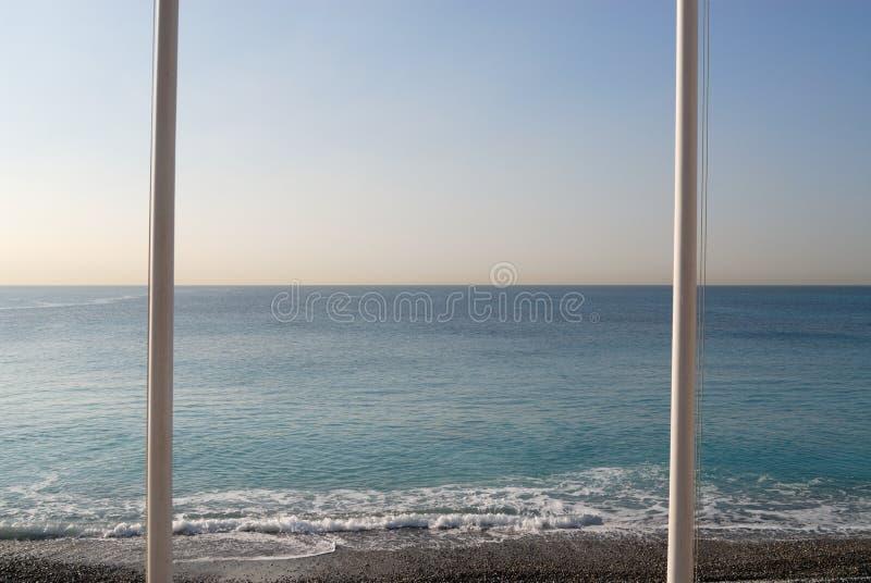 Astas de bandera en el mar Mediterráneo fotografía de archivo libre de regalías