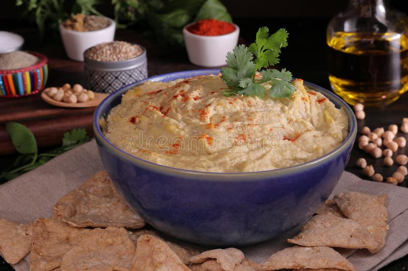 CHICKPEAS HUMUS BOWL WITH CILANTRO royalty free stock photo