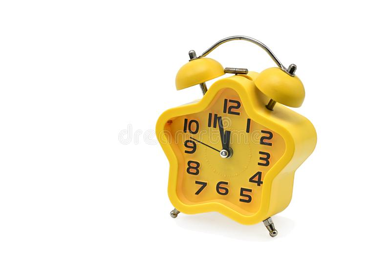 An asterisk Christmas clock showing residual time until midnight on a white background.Yellow.Twelve o`clock royalty free stock photo