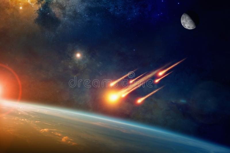 Group of burning exploding asteroids approaches to planet Earth. Asteroid impact, end of world, judgment day. Group of burning exploding asteroids from deep royalty free stock photography