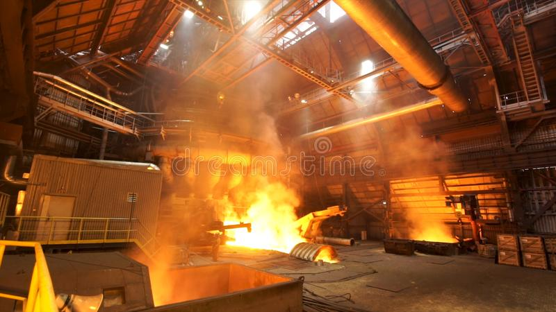 Asting ingots in foundry shop, metallurgical production. Stock footage. Melting steel at the plant, heavy industry and royalty free stock photos