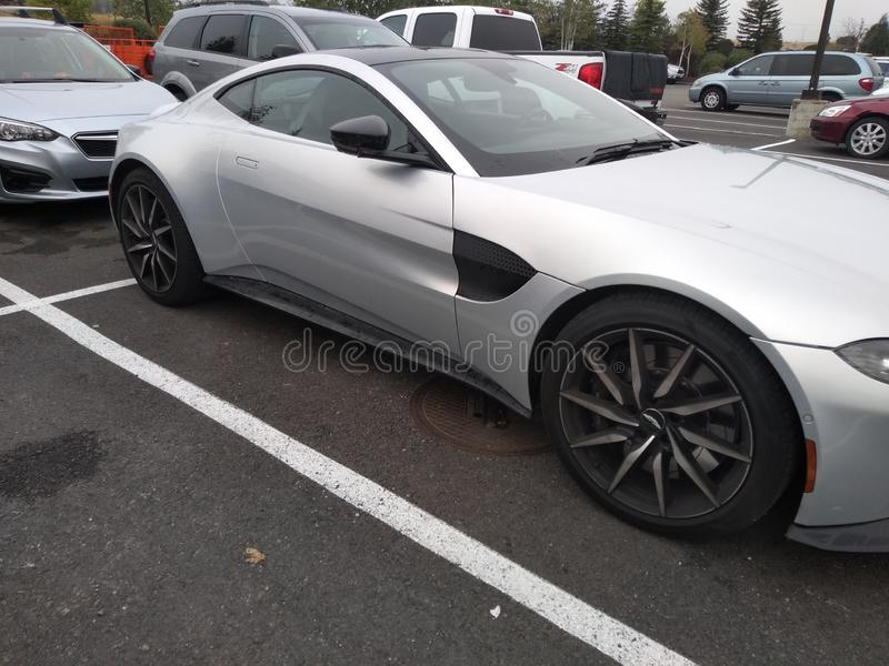 Aston Martin on a gloomy home Depot parking lot. Car stock photo