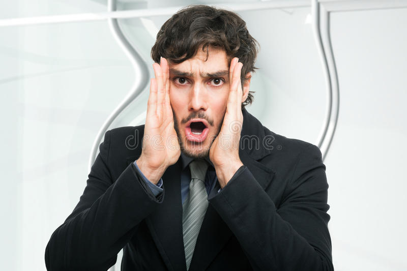 Astonished businessman in the office royalty free stock image