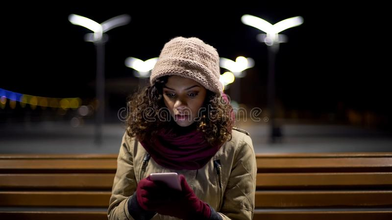 Astonished girl watching photos of ex-boyfriend with new girlfriend, using phone royalty free stock photos