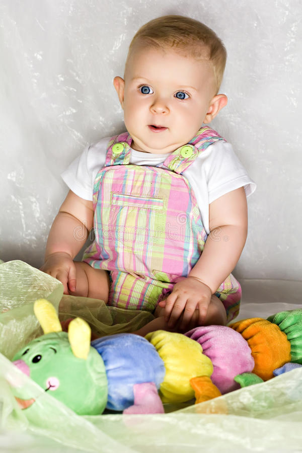 Download Astonished infant with toy stock photo. Image of humor - 26786646