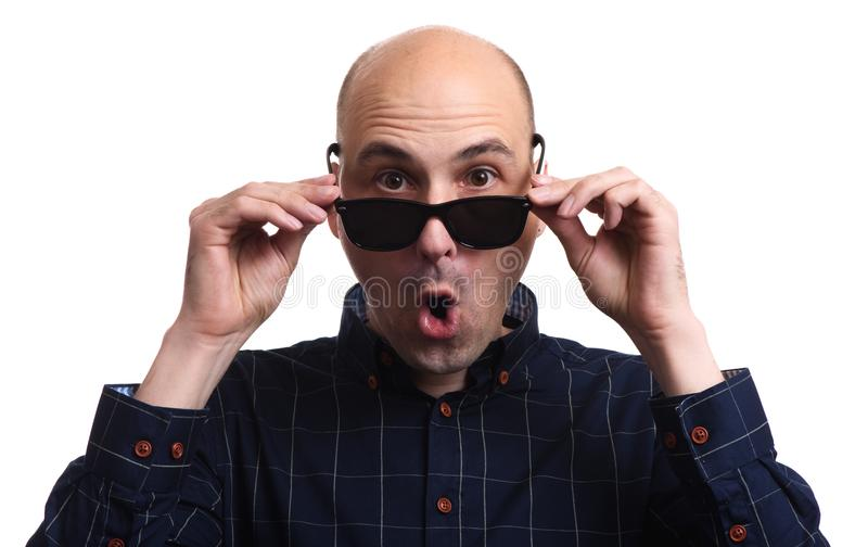 Astonished man looking at you. Isolated stock photography