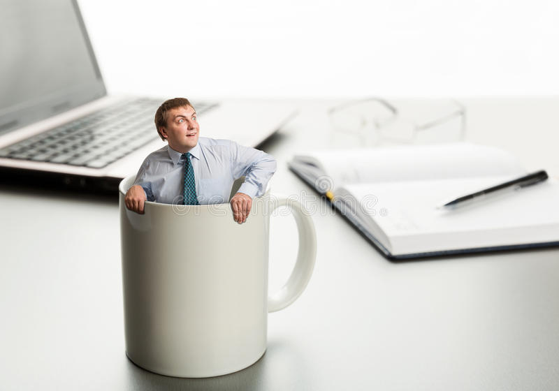 Astonished man in white cup royalty free stock image