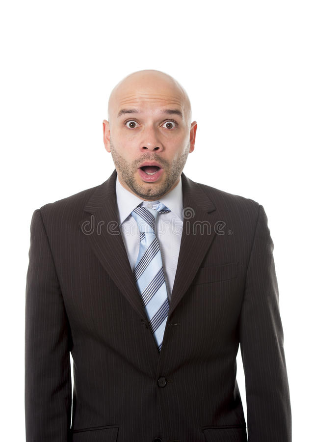 Astonished and surprised Hispanic businessman in suit and tie looking scared, clueless and confused with mouth open in shock royalty free stock photos
