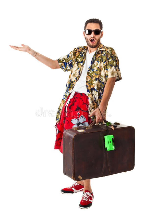 Astonished tourist. A young, attractive male in a colorful outfit ready to travel as a stereotype tourist stock images