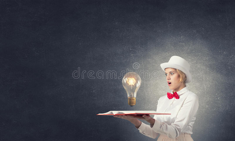 Download Astonished Woman Looking In Book Stock Photo - Image of muse,  intelligence: 63428018