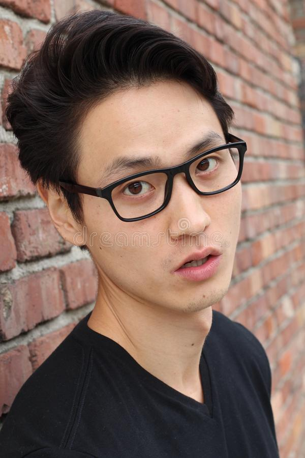 Astonished young Asian male close up royalty free stock images
