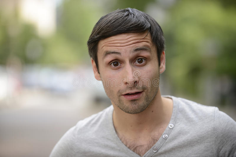 Astonished young man stock photo