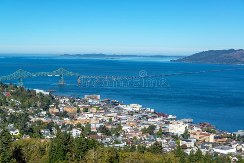 Astoria, Oregon Cityscape. Cityscape view of Astoria, Oregon with the Astoria Megler Bridge and Columbia River stock photo