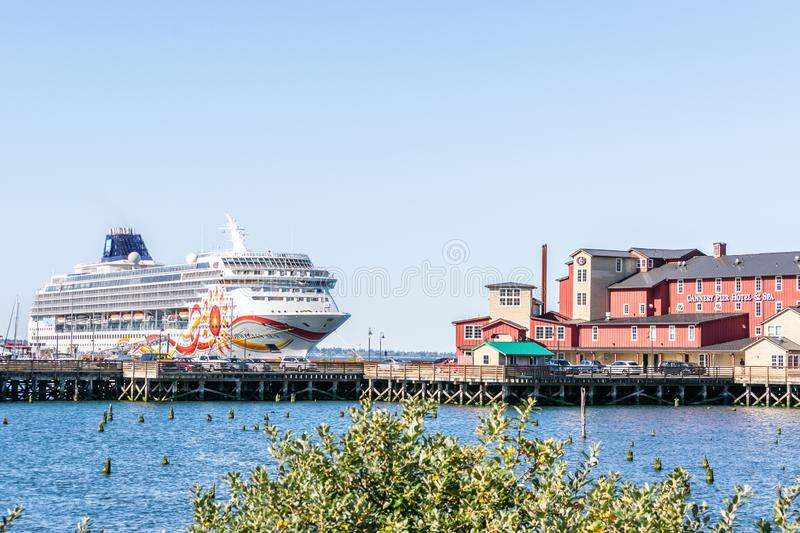 Norwegian NCL Sun cruise ship docked in downtown Astoria behind the Cannery Pier Hotel and Spa on the Columbia River. Astoria, Oregon - October 3, 2017 stock photo