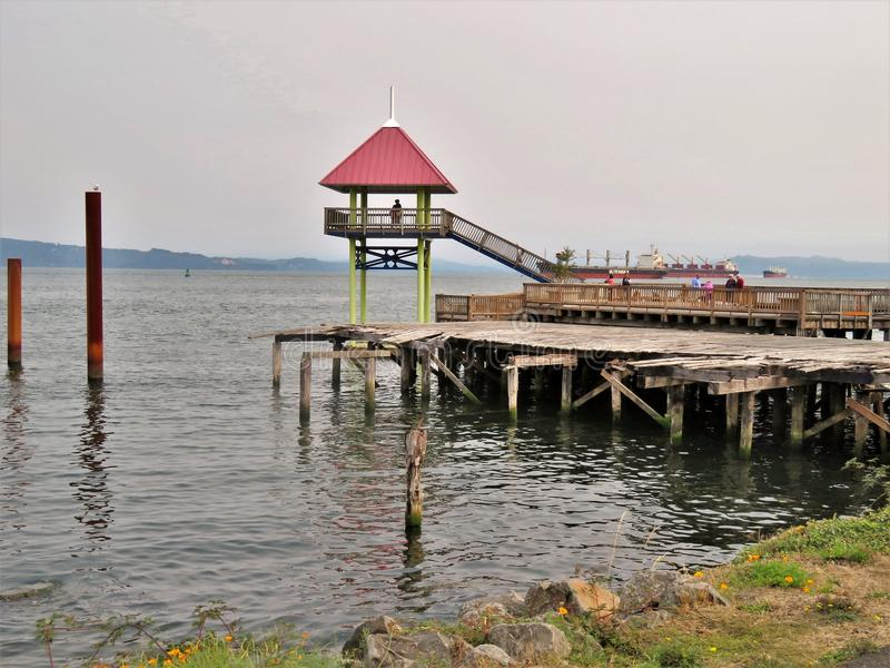 Astoria, Oregon, 9/16/2017, tourists explore a viewpoint and old dock and pier on the waterfront of Astoria stock photography