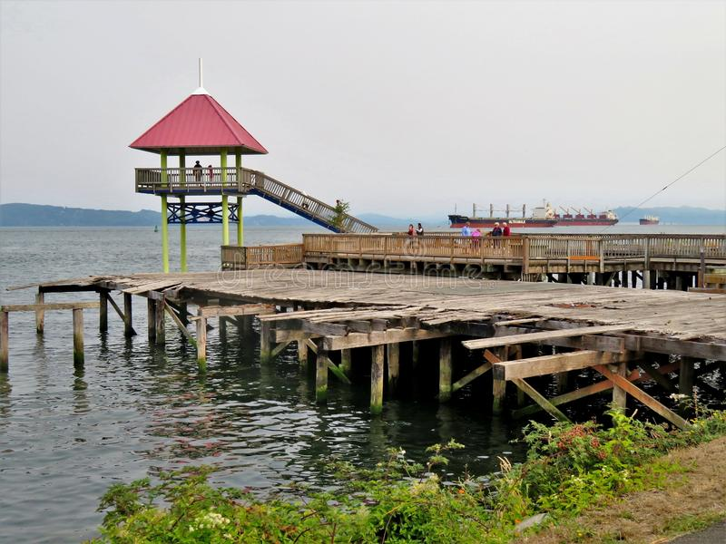 Astoria, Oregon, 9/16/2017, tourists explore a viewpoint and old dock and pier on the waterfront of Astoria royalty free stock photo