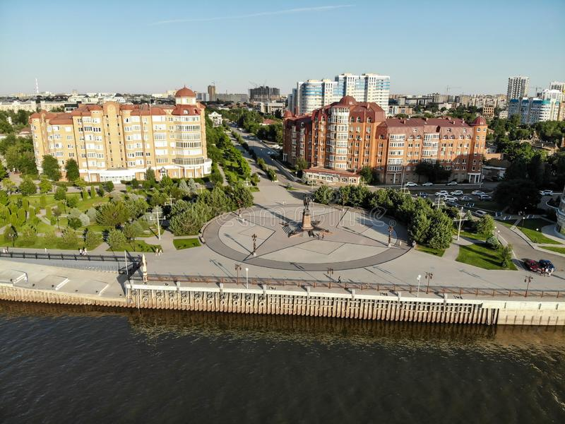 Astrakhan. The central embankment of the city. Monument to Peter 1 on the park for rest and walks. Panorama of the city of. Astrakhan. Bridge over the highway royalty free stock photo