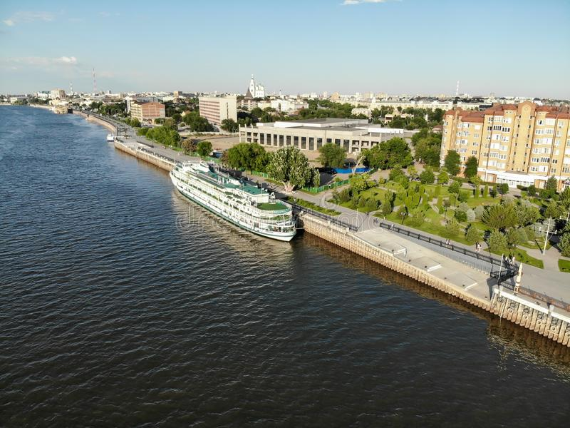 Astrakhan. A cruise ship. The central embankment of the city. Monument to Peter 1 on the park for rest and walks. Panorama of the. Passenger ship stands at the royalty free stock image