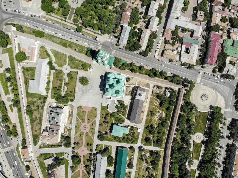 Astrakhan. Astrakhan Kremlin and Lenin Square top view. Fortress. Assumption Cathedral and the bell tower of the Astrakhan Kremlin. Flying drone over the stock images