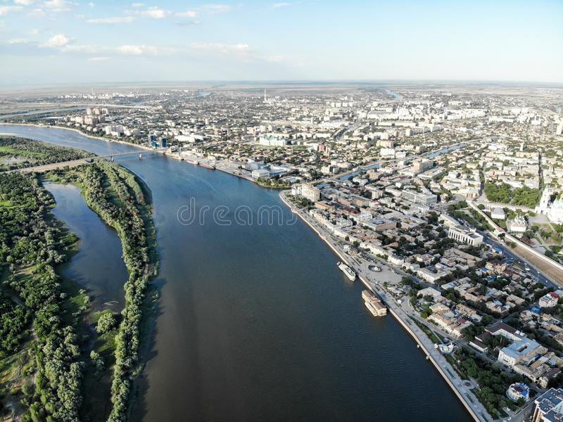 Astrakhan. Panorama of the city of Astrakhan. The central embankment of the city, Swan Lake. The bridge over the highway bridge. Across the Volga. Monument to royalty free stock photo