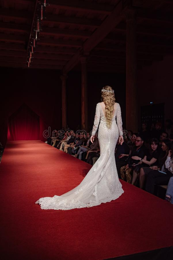 ASTRAKHAN RUSSIA - NOVEMBER 01, 2019. Caspian Fashion Week.Female models walk the runway in white wedding dresses royalty free stock image