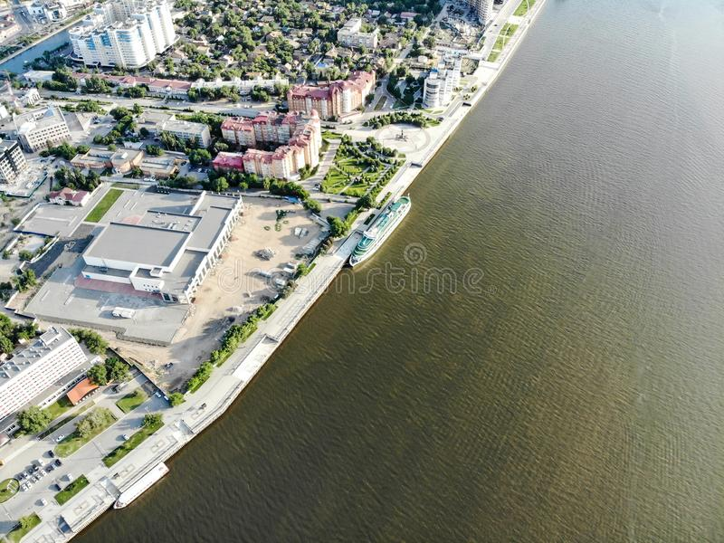 Astrakhan. Volga. A cruise ship. The central embankment of the city. Monument to Peter 1 on the park for rest and walks. Panorama. Of the city of Astrakhan stock photo