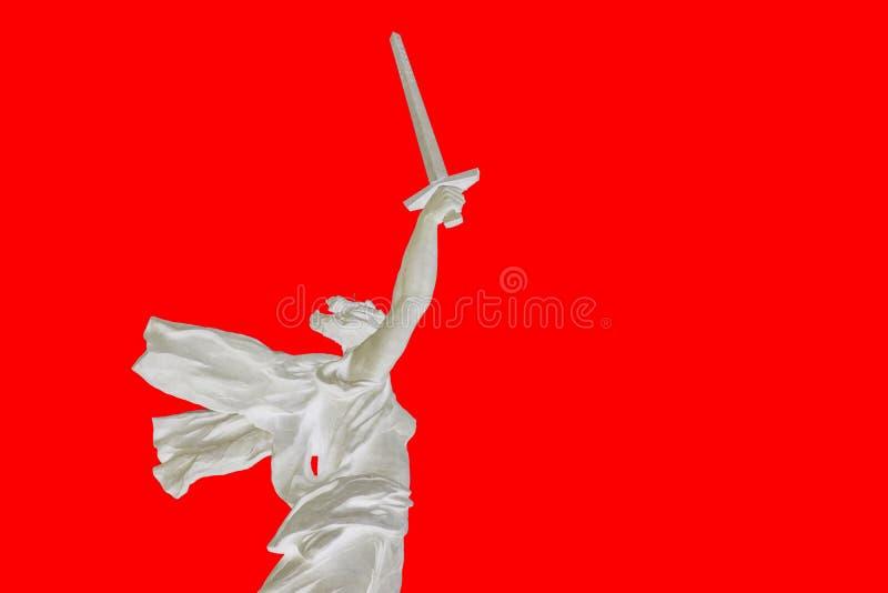Astrazione Siluetta su fondo rosso Mamaev Kurgan fotografie stock libere da diritti