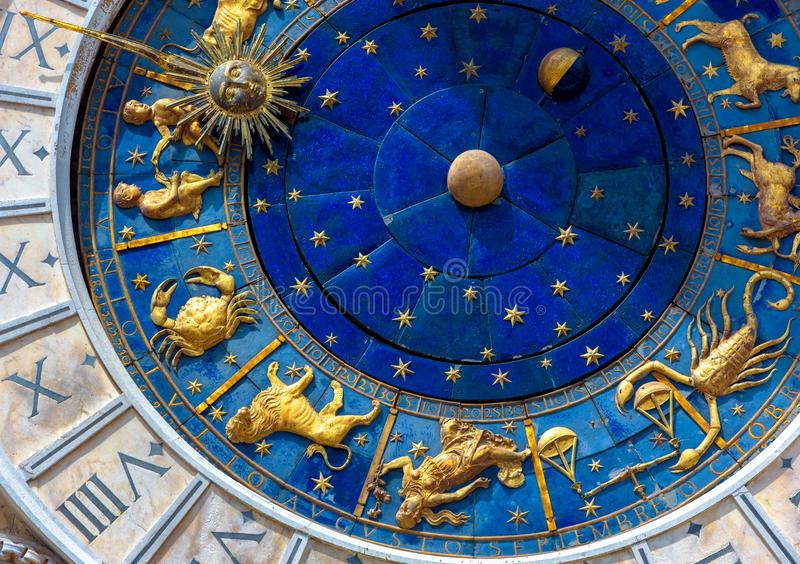 Astrological signs on ancient clock Torre dell`Orologio, Venice, Italy. Medieval Zodiac wheel and constellations. Golden symbols on star circle. Concept of royalty free stock photos