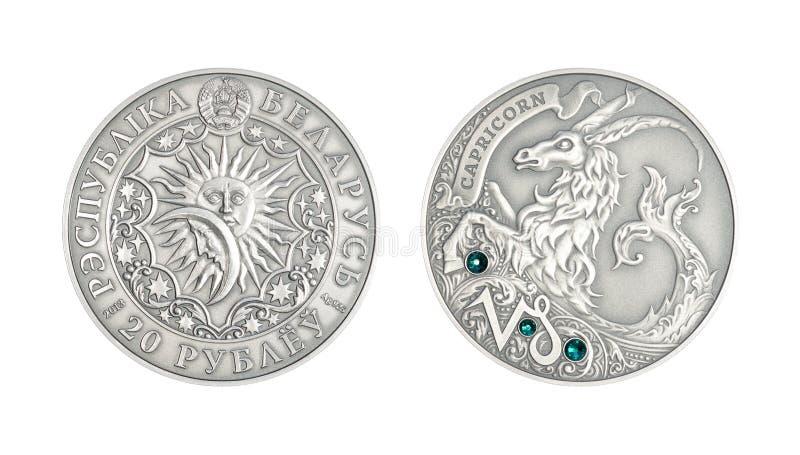Astrologisk teckenStenbocken för silvermynt arkivbilder