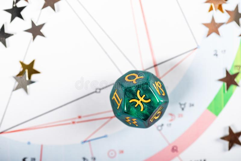 Astrology Dice with zodiac symbol of Pisces Feb 19 - Mar 20. On Natal Chart Background stock photos