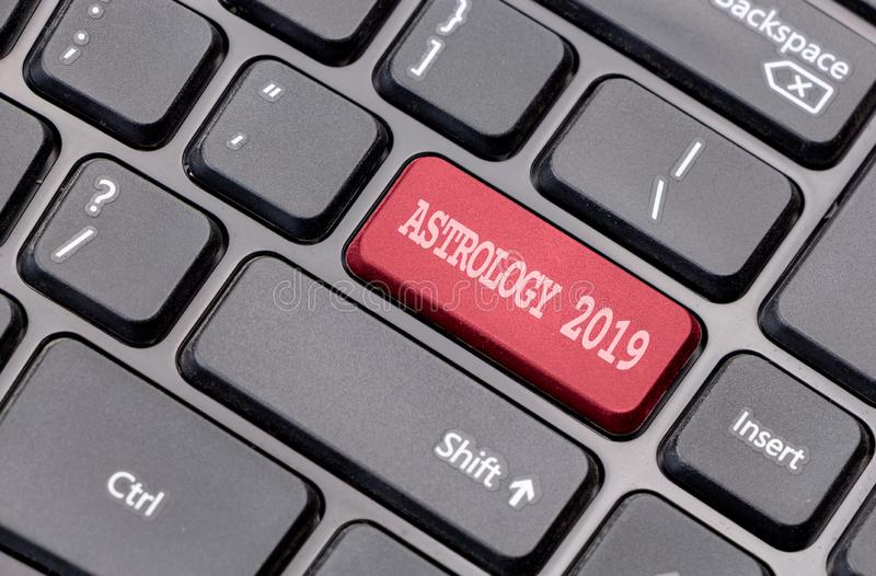 Astrology 2019 red on enter key, of a black keyboard. Astrology 2019 red on enter key, of a black keyboard royalty free stock image