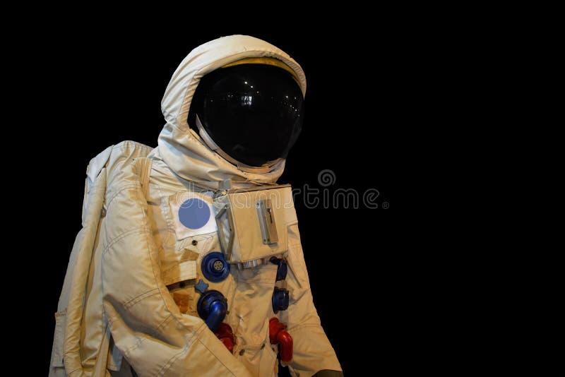 Astronaunt低角度射击和星后面地面 免版税库存图片