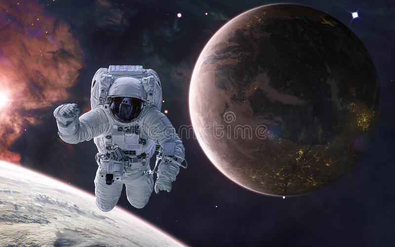 Astronaut on background of a colonized planet. Planets of deep space in warm starlight. Science fiction royalty free stock image
